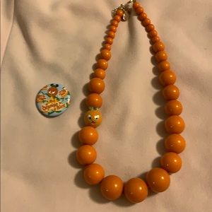 Orange bird Disney world necklace and button